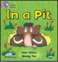 "Band 1A Reading Scheme Book - ""Sid is sad.  Dad is in a pit."""